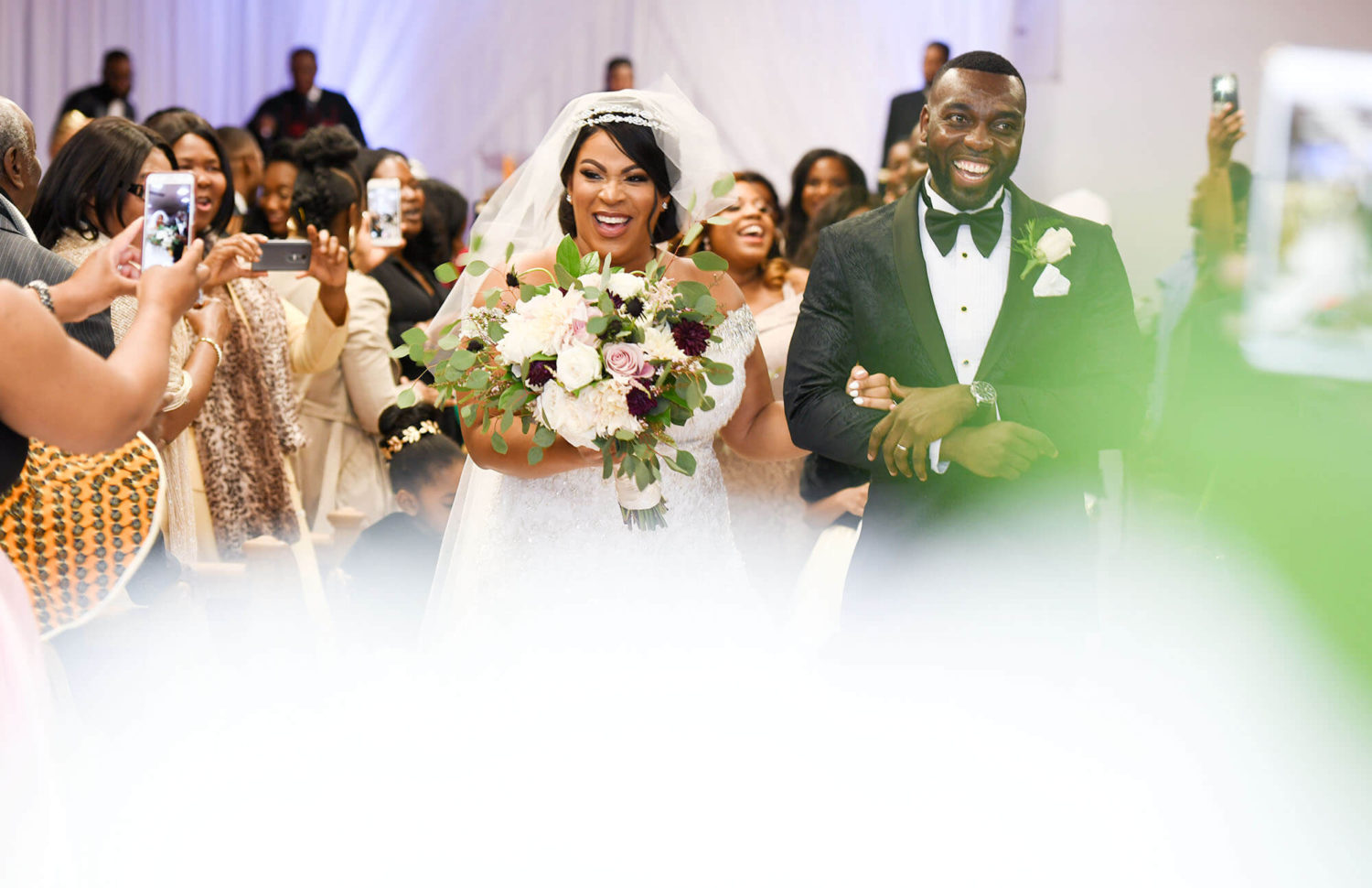 couple smiling down the aisle